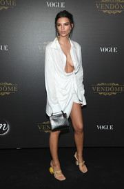 Emily Ratajkowski was white-hot in a cleavage-baring shirtdress by Jacquemus at the Vogue party in Paris.