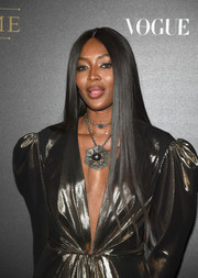 Naomi Campbell sported her signature sleek straight tresses at the Vogue party in Paris.