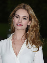 Lily James wore edgy-glam tousled waves during the Wimbledon party.