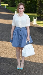Tanya Burr kept it modest in a short-sleeve white button-down during the Wimbledon party.