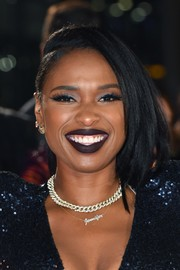 Jennifer Hudson went for a bold beauty look with a swipe of dark plum lipstick.