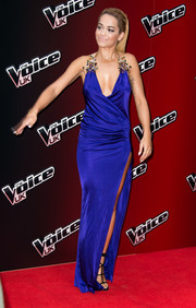 Rita Ora looked sizzling-hot at the 'Voice UK' series 4 launch in a cobalt Dsquared2 wrap gown with an up-to-the-hip slit and embellished shoulder straps.
