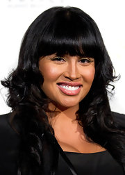 Somaya Reece styled her hair in long curls with blunt cut bangs at the Voices Against Brain Caner 2011 Benefit.