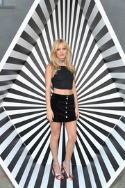 Georgia May Jagger matched her top with a button-front mini skirt, also by Volcom x GMJ.