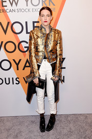 Riley Keough looked like a rock star in a metallic floral leather-panel coat by Louis Vuitton at the 'Volez, Voguez, Voyagez' exhibition opening.
