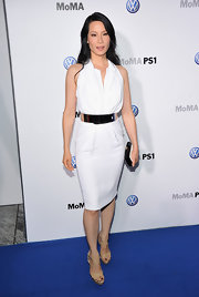 Lucy Liu vamped it up in sultry nude patent crisscrossing sandals.