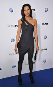Padma Lakshmi opted for a sleek look in black patent sandals worn with matching opaque tights.