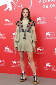 Raffey Cassidy kept it youthful at the Venice Film Festival photocall for 'Vox Lux' in a nude Louis Vuitton mini dress that came with a checkered sequin vest.