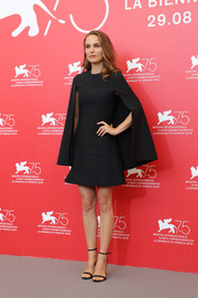Natalie Portman kept it minimal yet elegant in a cape-sleeve LBD by Dior at the Venice Film Festival photocall for 'Vox Lux.'