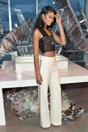 Chanel Iman was all sparkly and sexy in a beaded black crop-top by David Koma while celebrating the opening of W Dubai.