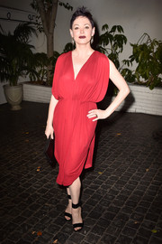 Rose McGowan's stunning red Grecian-inspired dress clung in all the right places at W Magazine's Golden Globes bash.