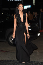 Chanel Iman had a dramatic entrance with her low cut black gown that showed a lot of leg with a thigh-high slit and featured a dazzling embroidered bodice.