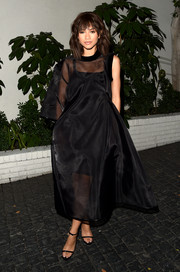 Zendaya Coleman was sheer elegance in a billowing black gown with one sleeve that she rocked with wispy, messy hair and strappy sandals.