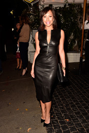 Cheryl Burke attended W Magazine's Golden Globes bash in a sexy figure-hugging leather dress.