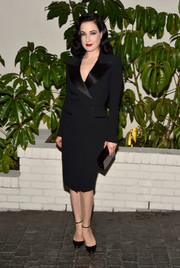 Dita Von Teese was as elegant as ever in a sleek tuxedo dress with gorgeous satin lapels by Saint Laurent.