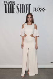 Barbara Palvin worked several trends with this cream-colored cold-shoulder cutout dress by Fame and Partners at the Shot event.