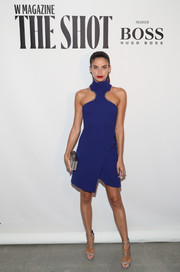 Sara Sampaio looked bold and stylish in a cobalt racer-neckline mini dress while attending the Shot event.