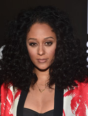 Tia Mowry wore her hair in a blast of curls during the W Magazine Shooting Stars exhibit opening.