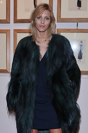 Anja Rubik paired a gold link necklace with a fur coat for a totally luxe look during the Thayaht Exhibition.