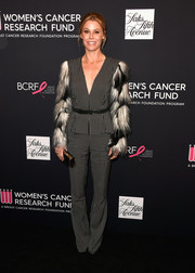 Julie Bowen went the fancy route in a monochrome Elisabetta Franchi jumpsuit with feathered sleeves during WCRF's An Unforgettable Evening.