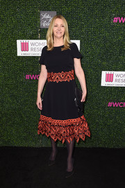 Lisa Kudrow donned a black midi dress with coral-hued embroidery along the waist and hem for WCRF's 'An Unforgettable Evening' event.
