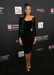 Jennifer Hudson oozed sexy glamour wearing this figure-hugging off-the-shoulder LBD by Saint Laurent during WCRF's An Unforgettable Evening.