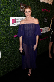 Erin Andrews flashed her undies in a sheer blue off-the-shoulder dress while attending WCRF's 'An Unforgettable Evening' event.