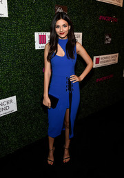 Victoria Justice was trendy and edgy in a blue Rebecca Vallance midi dress with a yoke cutout and a high front slit while attending WCRF's 'An Unforgettable Evening' event.