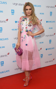 Tallia Storm finished off her ensemble with bright pink cage sandals by Kurt Geiger.