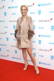 Rita Ora showed off a beige karakul and sable coat by Milusha London on the WE Day red carpet.