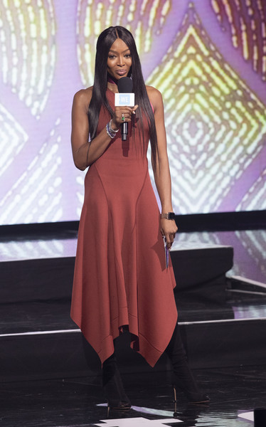 Naomi Campbell spoke onstage at WE Day UK 2019 wearing an antique-rose halter dress by Victoria Beckham.