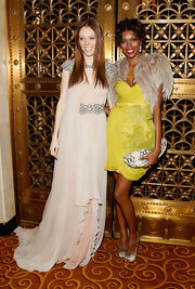 Jessica White was stunning in a soft yellow chiffon cocktail dress with a textured sckirt for the WGSN Global Fashion Awards.
