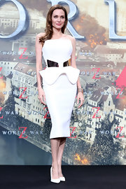 Angelina Jolie opted for a super sleek look with this strapless white frock that featured a structured peplum bodice, a gold plated waist, and a fitted pencil skirt.