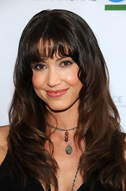 Shannon Elizabeth wore her hair in long layers with wispy brow-length bangs at a charity poker tournament.