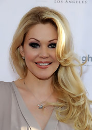 Shanna Moakler attended a charity poker tournament wearing her hair in long curled layers.