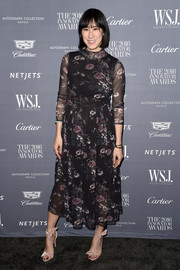 Eva Chen went ladylike in a high-neck floral dress by Ganni for the WSJ. Magazine 2016 Innovator Awards.