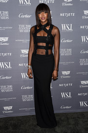 Naomi Campbell went for bondage glamour in a body-con black Tom Ford gown with a strappy bodice for the WSJ. Magazine 2016 Innovator Awards.