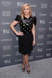 Reese Witherspoon polished off her look with black satin sandals by Jimmy Choo.
