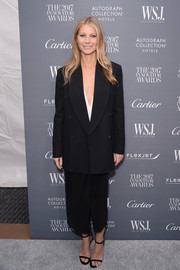 Gwyneth Paltrow finished off her outfit with a black sarong skirt, also by Michael Kors.