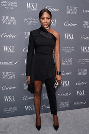 Naomi Campbell looked fashion-forward in an asymmetrical black jumpsuit by Jean Paul Gaultier at the WSJ. Magazine 2017 Innovator Awards.