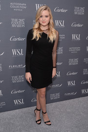 Ava Phillippe complemented her dress with black ankle-strap heels by Gianvito Rossi.