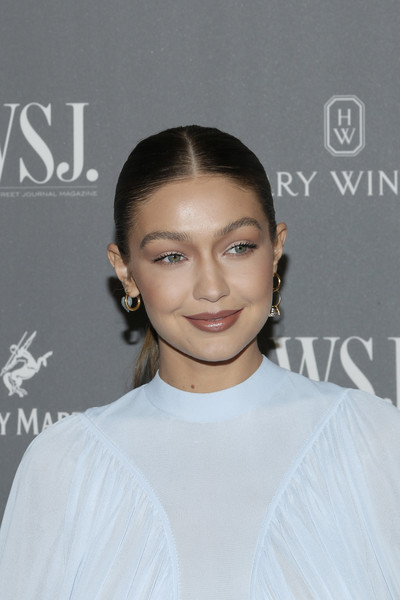 Gigi Hadid finished off her look with a pair of gold hoops.