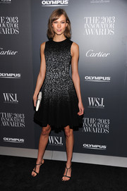 Karlie Kloss opted for classic black T-strap sandals to complete her ensemble.