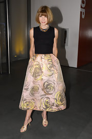 Anna Wintour's nude strappy slingbacks were a polished finish for her floral skirt.