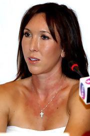 Jelena Jankovic adorned her decolletage with a simple cross pendant necklace at the 2010 WTA Championships previews.