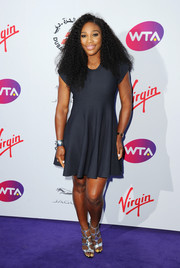 Serena Williams kept it fuss-free in a navy skater dress during the WTA pre-Wimbledon party.