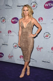 Caroline Wozniacki flaunted her fabulous physique in a body-con spaghetti-strap frock at the WTA pre-Wimbledon party.