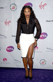Serena Williams was classic in a black wrap top with sheer sleeves at the WTA pre-Wimbledon party.