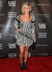 Kimberly Caldwell showed off a funky pair of lace-up ankle boots while hitting the red carpet at the WTB Fashion Show.