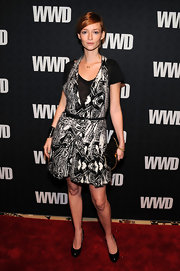 Audrey Marnay donned timeless black patent platforms. The heels toned down the bold print of her dress.